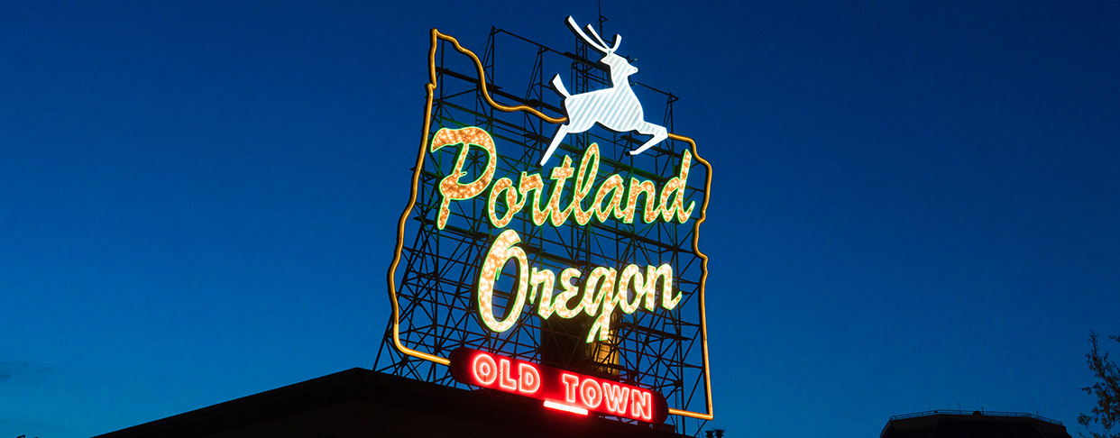 The Portland Old Town neon sign at night.