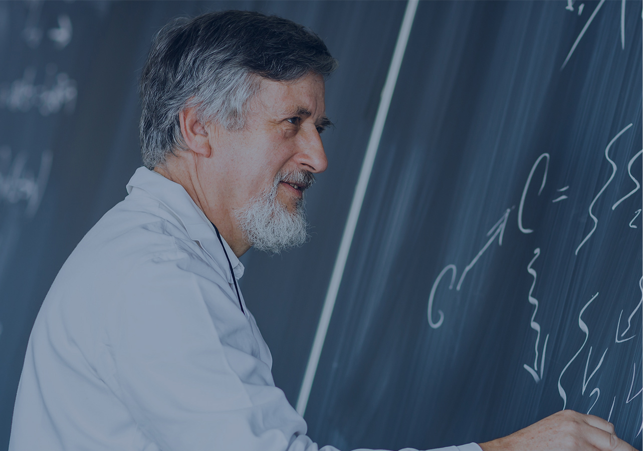 Male teacher at a blackboard