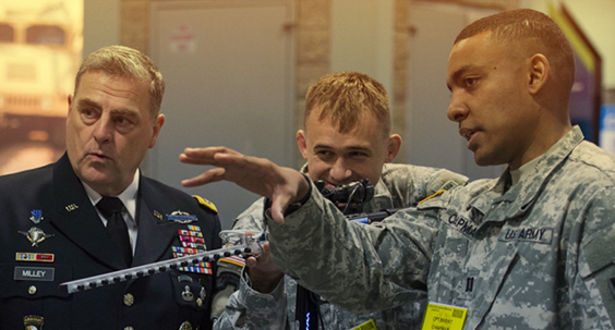 Capt. Erick Waage (center) demonstrating the Cyber Capability Rifle.